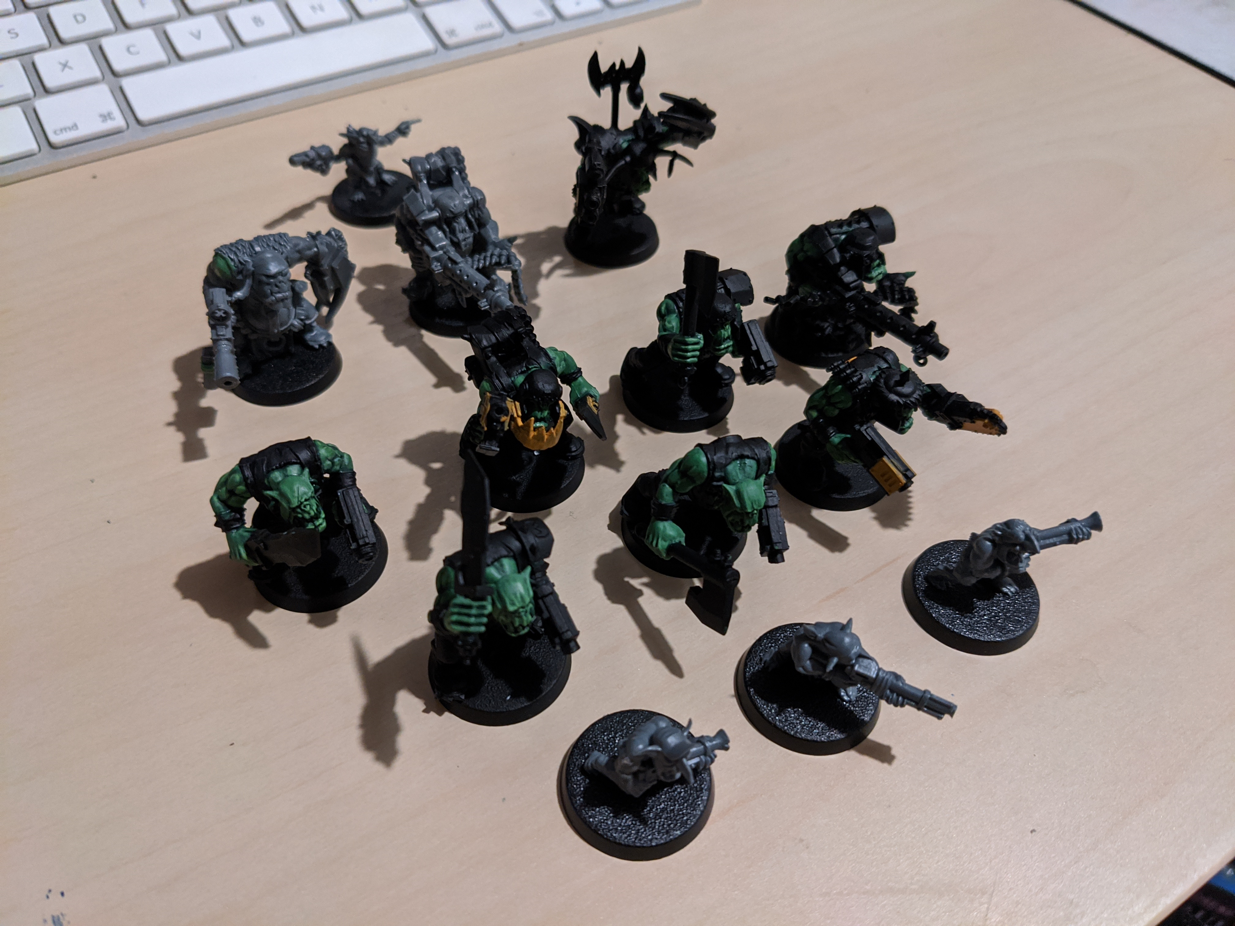 A squad of partially built Ork miniatures
