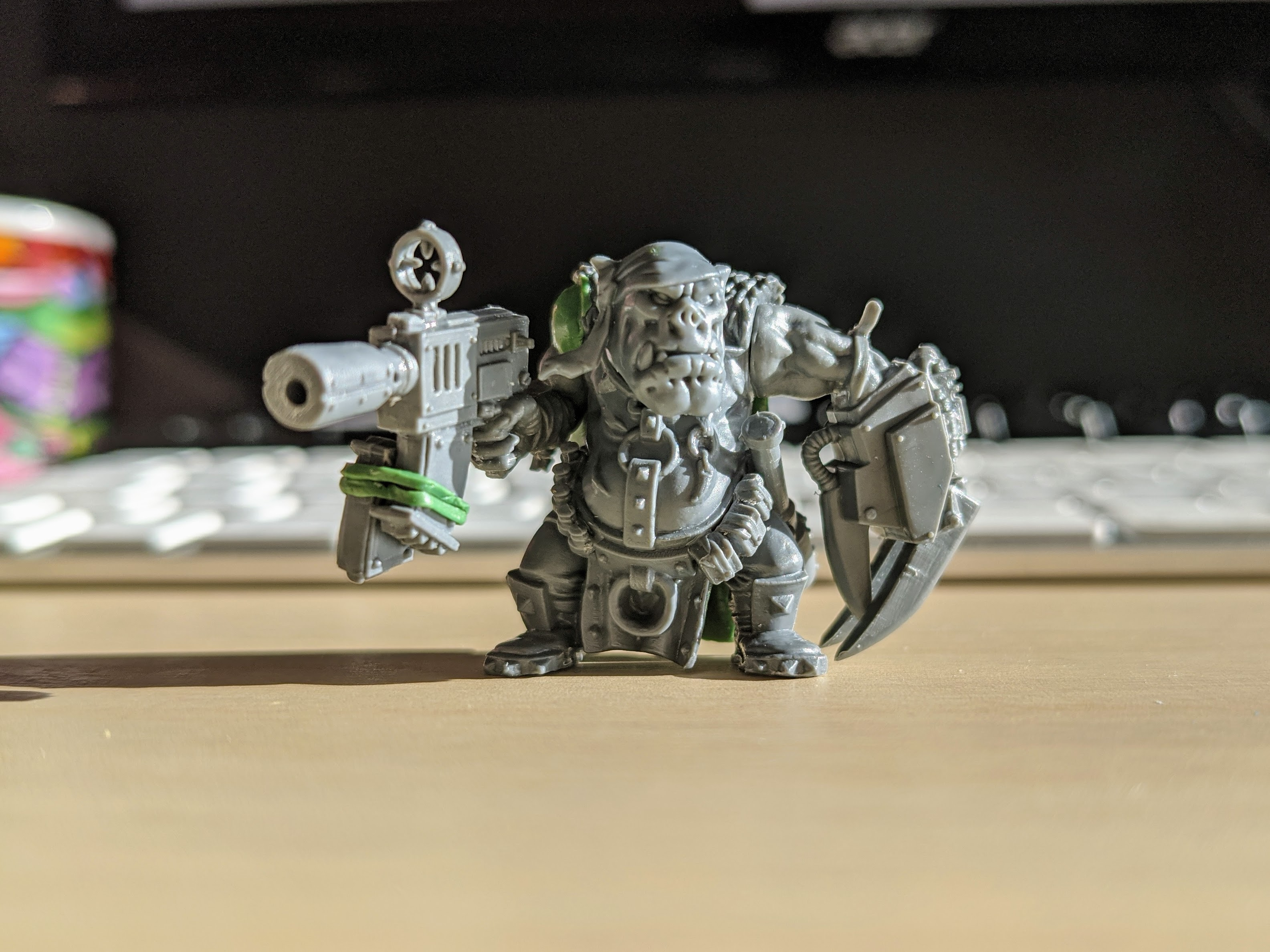 An Ork miniature with a kitbashed gun